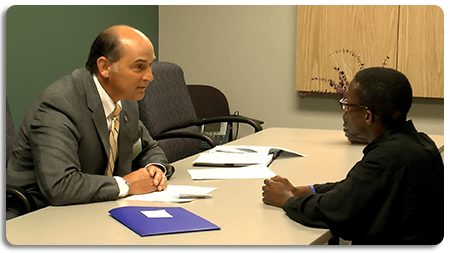 Volunteers help participants practice interviewing skills