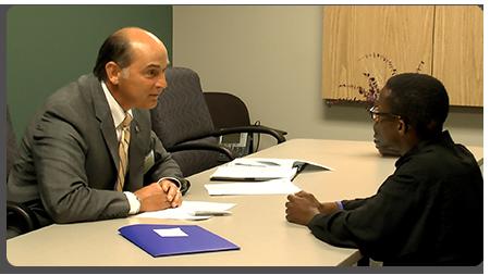Volunteers help participants practice interviewing skills